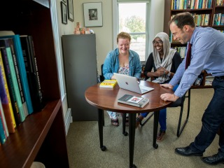Unidentified student with Farah Omer and Caleb Elfenbein